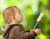 Portrait Of A Baby Holding Lollipop — Stock Photo