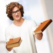 Portrait Of A Young Student Holding Books — Stock Photo #14421045