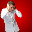 Portrait Of Young Man Covering His Ears With Hand — Stock Photo #14421649