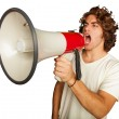 Portrait Of A Handsome Young Man Shouting With Megaphone — Stock Photo #14422311
