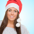 Happy woman wearing a christmas hat — Stock Photo