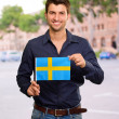 Potrait of a man holding flag — Stock Photo #14423253