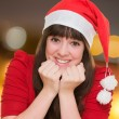 Portrait of a beautiful woman wearing a christmas hat — Stock Photo
