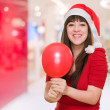 Happy christmas woman holding a balloon — Stock Photo #14425293