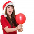 Surprised woman wearing a christmas hat and holding a balloon — Stock Photo #14425303