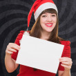 Happy christmas woman holding a blank card — Stock Photo #14425757
