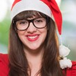 Portrait of a happy christmas woman wearing glasses — Stock Photo