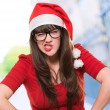 Angry christmas woman wearing glasses — Stock Photo