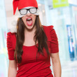 Angry christmas woman with a hat and glasses covering her eyes — Stock Photo