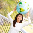 Women with globe on head — Stock Photo
