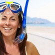 Portrait of a happy middle aged woman wearing snorkel and goggle — Stock Photo #14428245