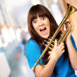 Surprised woman holding trumpet — Stock Photo #14428439