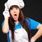 Portrait of female chef shocked — Stock Photo #14428497