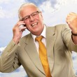 Senior Business Man Using Phone Cheering — Stock fotografie