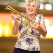 Portrait Of A Senior Woman Holding A Trumpet — Stock Photo