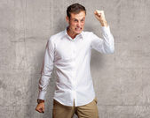 Portrait Of Angry Young Man Clenching His Fist — Stock Photo