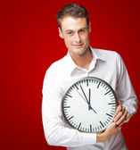 Happy Man Holding Clock In His Hand — Stock Photo