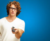 Man Holding Remote Control — Stock Photo
