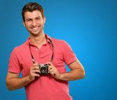 Portrait of a man holding camera — Stock Photo