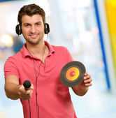 Portrait of man holding mike and disc — Stock Photo