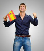 Man holding a flag and cheering — Stock Photo