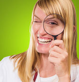 Happy Doctor Looking Through Magnifying Glass — Stock Photo