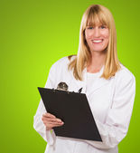 Portrait Of Happy Doctor Writing On Clipboard — Stockfoto