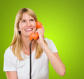 Pretty woman talking on telephone — Stock Photo