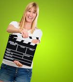 Happy Woman Holding Clapper Board — Stock Photo