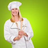 Female Chef Holding Wooden Spoon — Stock Photo
