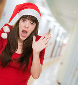 Surprised woman wearing a christmas hat — Stock Photo