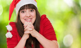 Excited woman wearing a christmas hat — Stock Photo