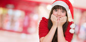 Extremely excited woman wearing a christmas hat — Stock Photo