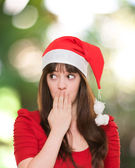 Christmas woman covering her mouth and looking to a side — Stock Photo