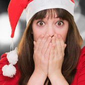 Closeup of a surprised christmas woman covering her mouth — Stock Photo