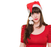 Confused woman wearing a christmas hat — Stock Photo