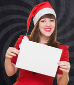 Happy christmas woman holding a blank card — Foto de Stock