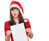 Worried christmas woman holding a blank card — Stock Photo