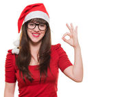 Christmas woman doing an ok gesture — Stock Photo