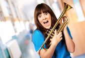 Surprised woman holding trumpet — Stock Photo