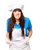 Portrait of a female chef clenching — Stock Photo
