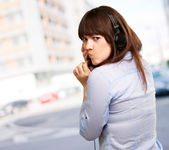 Woman With Headphones And Pouted Lips — Stockfoto