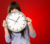 Woman Holding Clock Winking — Stock Photo