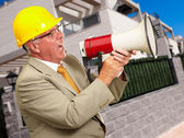 Senior Worker Shouting With Megaphone — Stock Photo