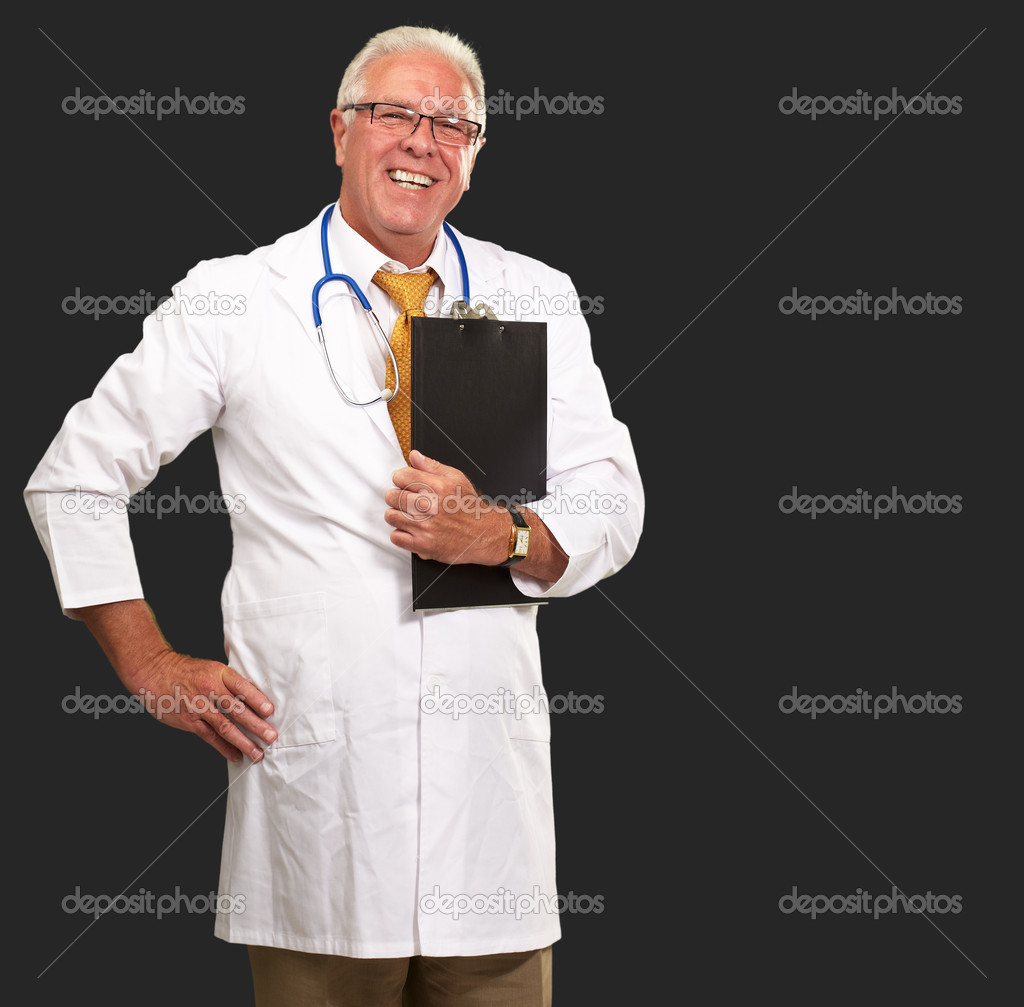 Portrait Of A Senior Doctor On Black Background — Stock Photo #14429149