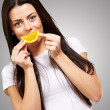 Young Girl Holding A Slice Of Orange — Stock Photo #14430109