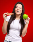 Female Holding A Piece Of Pizza And A Apple — Stock Photo