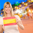 Happy Woman Holding Spanish Flag - Foto Stock
