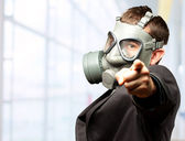 Businessman Pointing With Gas Mask — Stock Photo
