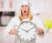 Shocked Female Chef Holding Clock — Stock Photo